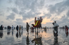 Clifton Beach Karachi Pakistan. Clifton Beach at Karachi Pakistan is one of the most beautiful places in Pakistan where people can ride camels, eat corn and Royalty Free Stock Images