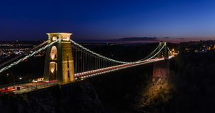 Clifton Suspension Bridge, Clifton, Bristol. Looking out over Clifton Suspension Bridge from near the Clifton Observatory. with the city lights in the distance Stock Image