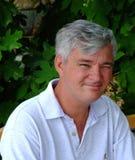 Cligner de l'oeil de sourire d'homme de Chéri-Boomer Images libres de droits