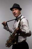 Cligner de l'oeil le joueur de saxophone Images stock