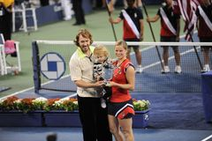 Clijsters winner of US Open 2009 (147). Kim Clijsters is Ladies Champion of US Open 2009 with her family Stock Photos