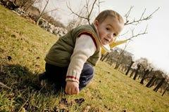 Clild in garden Stock Photography
