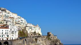 Clill side village homes and sea of the Amalfi coast in Italy. Amalfi, Italy - March 29 2017: Cliff side village homes and sea of the Amalfi coast in Italy royalty free stock photo