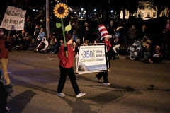 Climate advocates carry signs in Oregon holiday parade Stock Images