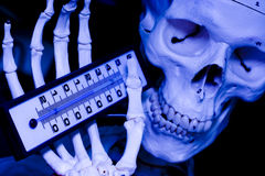 Climate change. Skull holding a thermometer. A metaphor of the Climate change Stock Photos