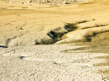 Climate change concept, dried surface of desert. Ground. Big cracks and fractures of lake sediments with traces of water royalty free stock photos