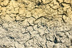 Climate change concept, dried surface of desert. Ground. Big cracks and shadows of lake sediments royalty free stock images