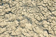 Climate change concept, dried surface of desert ground. Big cracks and shadows of lake sediments stock photography