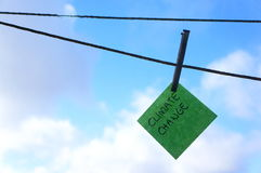 Climate change, global warming concept, post it note, washing line Royalty Free Stock Photography