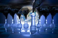 Climate Change Global Warming Earth Pollution. A conceptual image of global warming using chess, earth and smoke stacks