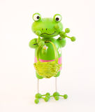 Climate change: going green !. A little green man, resembling a frog isolated on a white background. An image meant to amuse and to be used in the debate over Royalty Free Stock Photo