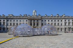 Climate change Pinksy pollution pods. SOMERSET HOUSE, LONDON, UK - APRIL 22nd 2018: Pinksy Pollution Pod exhibit in the centre of the square inside Somerset stock photos