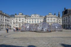 Climate change Pinksy pollution pods. SOMERSET HOUSE, LONDON, UK - APRIL 22nd 2018: Pinksy Pollution Pod exhibit in the centre of the square inside Somerset stock photo