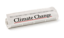 Climate change. Rolled newspaper with the headline Climate change royalty free stock image