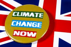 Climate Change and the UK. London, UK - May 29th 2019: Climate Change Now badge, pictured over the flag of the United Kingdom royalty free stock photos