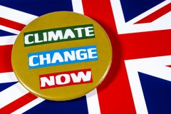 Climate Change and the UK. London, UK - May 29th 2019: Climate Change Now badge, pictured over the flag of the United Kingdom royalty free stock photography