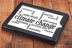 Climate change word cloud on tablet Royalty Free Stock Photos
