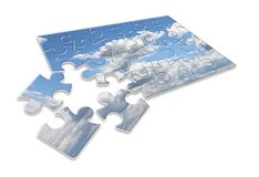 Climate changes; concept image with a cloudy sky in puzzle shape.  royalty free stock photography