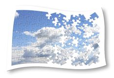 Climate changes concept image with a cloudy sky in puzzle shape.  royalty free stock photography