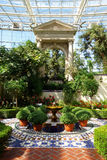 Climate controlled formal indoor garden. Antique portico overlooking Moorish-style garden, a center piece of the Shoenberg Temperate House, an indoor, climate stock photos