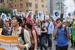 Climate March NYC 2014. New Yorkers come in the thousands in the streets of New York to demostrate in favor of climate control, with the objective of sending a Stock Images