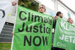 Climate protest. Climate activists at the COP21 UN climate summit in Paris, France, stage a protest calling for climate justice now, December 1, 2015 Stock Photo