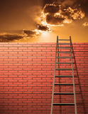 Climb. Ladder leans on wall with sky Royalty Free Stock Image