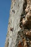 The climb. Climbing high wall in Tajikistan Royalty Free Stock Photo