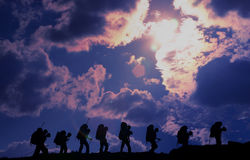 Climb. Group of climbers on rise on a crest of mountain Royalty Free Stock Photo