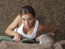 Climb. An attractive woman climbs at the gym as seen from above Stock Photos