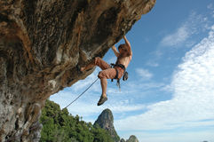 Climb on!. Adult climbing hard overhanging wall in Krabi, Thailand Royalty Free Stock Image
