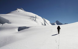 The climb on the Ishinca peak. Silhouette climber on the peak Ishinca Royalty Free Stock Photo