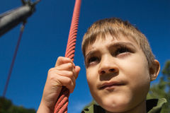 Climb and jump. Close up of a child Stock Image