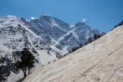 Climb the mountain on the red snow. In winter royalty free stock photo