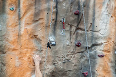 Climb to success concept. Human hand gripping on a climbing wall Stock Image