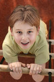 Climb to the top. Boy on a wood and rope ladder (playground stock image