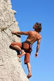 Climb the wall!. Climber on the vertical wall Royalty Free Stock Photography