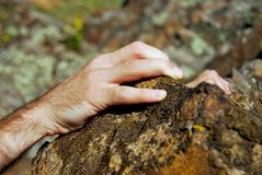 Climber´s hand on sandstone rock Royalty Free Stock Photos