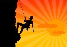 Climber. On the rock by the sunrise Stock Photos