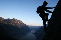 Climber. Silhouette of a climber in the Alps Stock Images