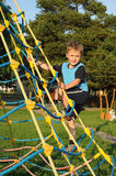 Climber. Young climber, a little boy, having fun on a playground Stock Photography