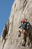 Climber. Rock climber on a high rock wall Stock Photo