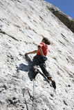Climber. Young active male rock climbing Stock Image