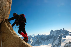 Climber. On the Cosmiques ridge, Aiguille du Midi, Chamonix, Mont Blanc, West Alps, France, europe Stock Images