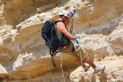 Climber. With ropes to climb the mountain Stock Photos