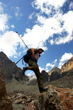 Climber. Jumping alpinist stock images