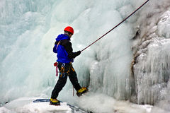 Climber. Holding a cable on a frozen waterfall Royalty Free Stock Photography