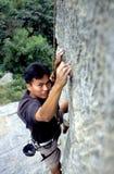 Climber. A climber were practicing climb rock stock image