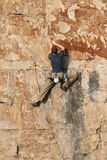 The Climber 5. Ascending sheer rockface Stock Image