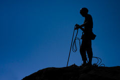 Climber. Silhouette against a deep blue sky Stock Photo